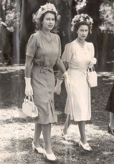 W/ sister, Princess Margaret (R) — & dressed almost identically — the 21-yr-old Princess Elizabeth is already setting trends in her box-pleat dress, cinched w/ a bow to show off her tiny waist. The white gloves, neat handbag & co-ordinating peep-toe slingbacks show a keen eye for detail | As Queen Elizabeth II celeb. her 90th b-day, let's looks back at some of her most Iconic Style Moments | 21 Apr 2016