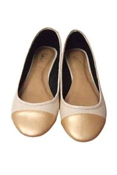 Cream colored captoed flats from Satchi Store