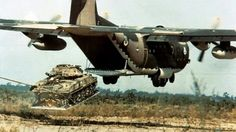 A Lockheed C-130 Hercules air dropping a M551 Sheridan tank using LAPES (Low Altitude Parachute Extraction System).
