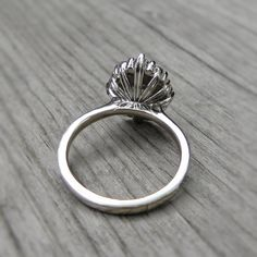 A vintage-inspired halo ring with a colorless Forever One Hearts & Arrows or Supernova moissanite. Conflict-free lab-grown or Canadian mined diamond halo encircles the round moissanite. Pear Diamond, Diamond Bands, Halo Diamond, Diamond Cuts, Sapphire Diamond, Perfect Engagement Ring, Diamond Engagement Rings, Halo Engagement, Peach Sapphire