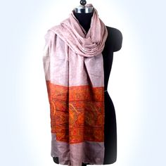 This lightweight accessory is infused with Wool for an airy drape and Intricately woven in Maroon, Brown, Cream colors and Border Design with subtle embellishment.