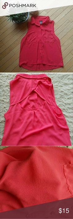 Coral Keyhole Back Wet Seal Button Up Tank SIZE: Medium  BRAND: Wet Seal  COLOR: Coral  FIT: Button UP Muscle Tee  USAGE: Worn a few times MEASUREMENTS: (Inches)  LENGTH: 20 5/8 (Front)  22 5/8 (Back)  CHEST: 15  **Please see my post with the diagrams of how measurements are taken**  Bundle & save on shipping  Also listed on Merc & Vinted Wet Seal Tops Tank Tops