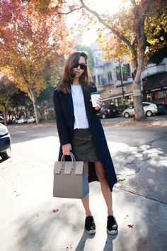 Street Style December 2014: Rumi Neeley is wearing a dark blue mohair jacket from Cos, T-shirt from Are You Am I, olive leather skirt from Isabel Marant, khaki bag from Mezzi Cosima and the espadrilles are from Céline