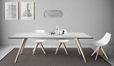 Dining table with top made of marble, wood or glass