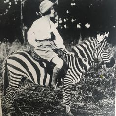 Explorer, Osa Johnson, riding a zebra in Kenya, 1930