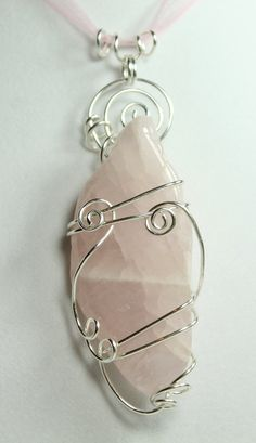 Handmade Healing Crystal Pendant: Freeform Pink Rose Quartz Silver Wire Wrapped Pendant. $25.00, via Etsy.