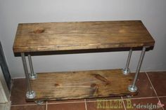 Mom needs a shelf...DIY Furniture Plan: It's made from simple pine 2x12 shelves, castors and plumbing hardware.
