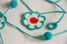 Flower and Bauble Crochet Garland Aqua Red White by BobbiLewin on Etsy Crochet Bunting, Crochet Garland, Crochet Quilt, Crochet Trim, Love Crochet, Diy Crochet, Crochet Crafts, Yarn Crafts, Crochet Flowers
