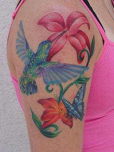Hummingbird, butterfly, and flowers tattoo
