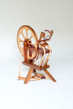 Laminated Spinning Wheel; Mahogany and rock Maple by Five-One-Two Custom Woodworking