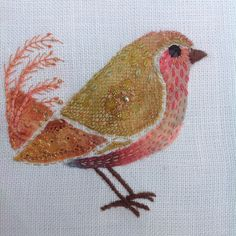 Hand stitched bird using dyed lace scraps.Debbie Irving