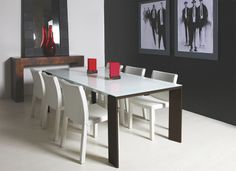 Sando Dining Table, top in white glass, frame in stainless steel and legs in solid wood. Sando Dining Chair, upholstered in aniline leather Trento White.