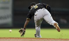 Josh Harrison #5 of the Pittsburgh Pirates attempts to field a ground ball up the middle against the Houston Astros at Minute Maid Park on September 23, 2012 in Houston, Texas.  (September 22, 2012 - Source: Bob Levey/Getty Images North America)