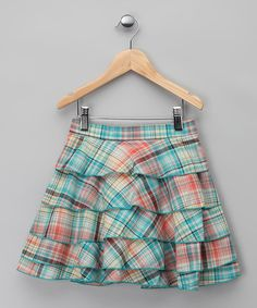 Reminiscent of a picnic in springtime and as soft as a flower's petals, this adorable skirt boasts a pretty print and dainty crocheted details. Tiers of breezy ruffles cascade from an elastic waistband that creates a just-right fit.