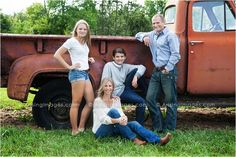 Fun family photo at our farm with a rustic truck. Love the pose and composition!