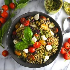 Pesto Couscous Salad with Mozzarella and Tomatoes is a perfect summer lunch or light dinner. As pretty as it is delicious.