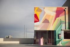 Z Deck, a parking garage by Neumann/Smith Architecture and Bedrock that features commissioned murals