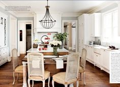 PERFECT eat-in kitchen attached to an island to make the most of a space - love the #rustic and white combo