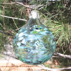 Blown Glass Ornament in Blues and Greens by @LindsaysDesigns, available on Etsy for $15.  #ornament #handmadeornament #christmasgift #christmasdecorations #blownglass