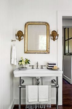The Space: A wide but shallow wall-mounted sink preserves square footage and doubles as a towel rack. The Space Saver: Heather retrofitted this existing medicine cabinet, removing the wood shelves and adding glass ones for a cleaner look. She then substituted a larger mirror for the existing one. The Styling: On the sink surface, try stacking both light and dark washcloths so you can wipe off makeup without leaving stains. The Unexpected: A piano hinge, also known as a continuous hinge,...