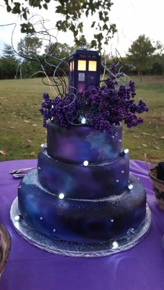 Our TARDIS wedding cake. It went great with our space theme. It has a nebula airbrush on fondant. We had blue raspberry,  chocolate and strawberry cake layers. ♡ Doctor Who