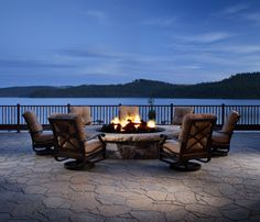 The beauty of sitting on the lake on a Belgard patio with a Belgard firepit.