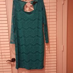 Dress Brand new never been worn 14/16 turquoise. Peep hole in the back. Make an offer! Ashley Stewart Dresses Midi