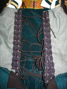 a756380039 Grommet tape for ladder lacing a Venetian gown.