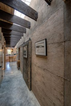 Contemporary Hall by Copeland Architecture & Construction Inc. Poured concrete walls and buffed cement floors. LOVE it!