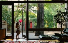I love how this deck extends the interior without unsettling existing trees, etc. Would love to consider something like this off of the sun room.