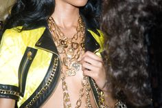 Layered gold chains at Moschino