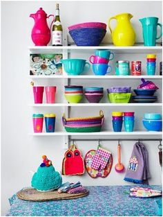 I have so much colorful kitchenware....I need to display it all like this.  It's too pretty to be hidden in a cupboard.