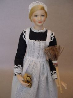 Inspired by the lady's maid, Anna Smith, from Downton Abbey, this dollshouse doll was created from porcelain by Debbie Dixon-Paver.