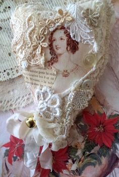 elegant heart, to hang on a tree or anywhere for the holidays made of lace collage with image and buttons old French book page added one of Shakespeares ladies adorned with a bell accent 6 inches has a lace hanger