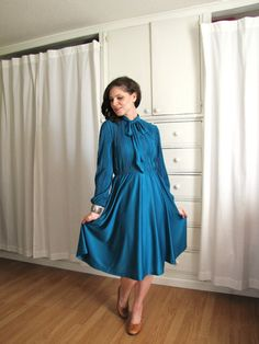 1970s teal pleated secretary dress. I'll add black knee boots