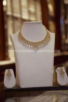 gold polki pearl necklace with matching earrings. For inquiries please conta. Pearl Necklace Designs, Gold Earrings Designs, Gold Jewellery Design, Gold Necklace, Fancy Jewellery, Diamond Necklaces, Necklace Set, Silver Earrings, Art Nouveau
