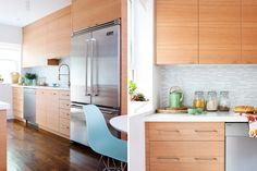 Marion Melbourne wood grain kitchen cabinets. backsplash. faucet. white countertops.