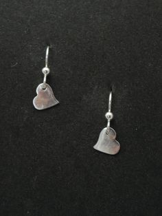 Sterling Silver with Silver hearts.