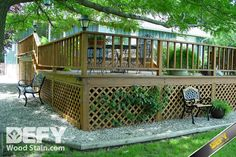 DEFY Extreme Wood Stain in cedar tone on a redwood deck with lattice