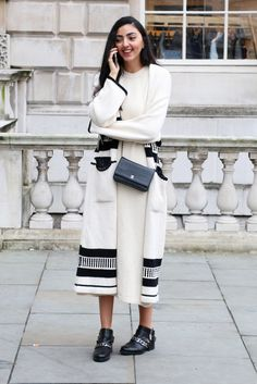 London Fashion Week Street Style: long graphic coat over knit dress, great shoes, small leather bag