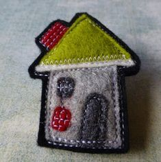 eclectic me blog: little houses made of felt - felt brooches made by Gillian Hamilton