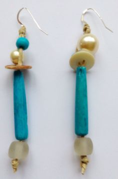 LillyLoop Jewellery earrings part of the ALOHA collection. Vintage pearl button, turquoise coloured bone, pearl, shell and glass beads, on unwaxed organic cord and 925 ear wires....www.lillyloop.co.uk.