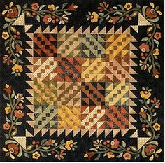 There's just something about black and appliqued borders that make quilts pop.