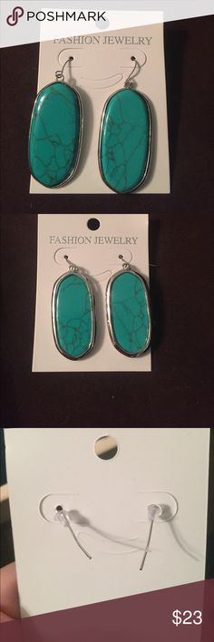 Real Turquoise earrings 18k white gold over brass Beautiful turquoise oval earrings never worn !! Fish hook backings , 18k white gold over brass , nickel and lead free. Dimensions: 40mmx40mmx4. December birthstone! Jewelry Earrings