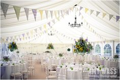 Multi-coloured Bunting and huge sunflower displays - colourful Marquee Design {theweddinghunter}