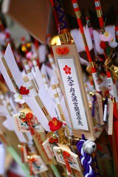 Japanese wooden arrow decorated with small votive plaques for a good luck charm, Hamaya 破魔矢