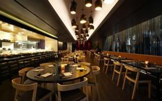 elegance restaurant interior design with small pendant lamps also round and rectangular table and bar in the nearby