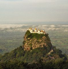 Popa Taungkalat temple, Myanmar. Only 777 steps to the shrine at the top of the peak.