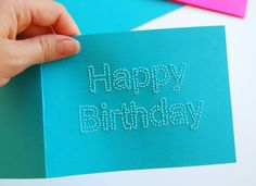 make a card by pricking it with a pin