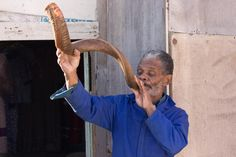 Man from the Nama tribe blowing a shofar (Namibia)